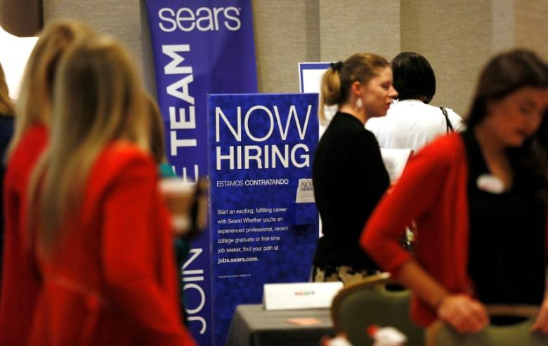 Recruiters and job seekers are seen at a job fair in Golden, Colorado, June 7, 2017. REUTERS/Rick Wilking