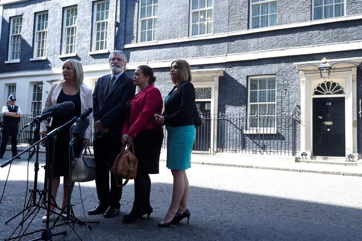 A Sinn Fein delegation, including President, Gerry Adams, and the leader of Sinn Fein in Northern Ireland, Michelle O'Neill, talk to the media outside 10 Downing Street in central London, Britain June 15, 2017. REUTERS/Phil Noble