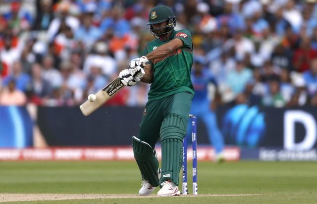 Britain Cricket - India v Bangladesh - 2017 ICC Champions Trophy Semi Final - Edgbaston - June 15, 2017 Bangladesh's Mashrafe Mortaza hits a four  Action Images via Reuters / Andrew Boyers Livepic