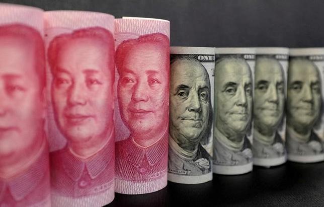 6月15日、米財務省が発表した4月の対米証券投資統計によると、中国の米財務省証券保有が3カ月連続で増加し、6カ月ぶりの高水準となった。2016年1月撮影(2017年 ロイター/Jason Lee/Illustration)