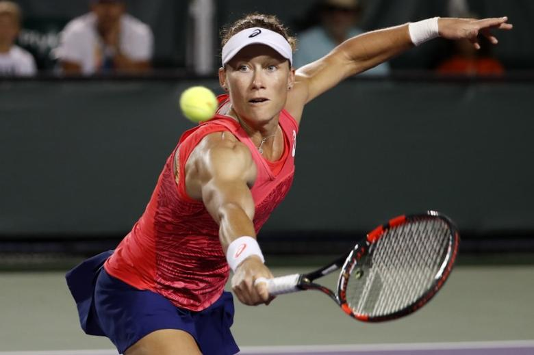 FILE PHOTO: Mar 27, 2017; Miami, FL, USA; Samantha Stosur of Australia hits a volley against Simona Halep of Romania (not pictured) on day seven of the 2017 Miami Open at Crandon Park Tennis Center. Halep won 4-6, 7-5, 6-2. Geoff Burke-USA TODAY Sports