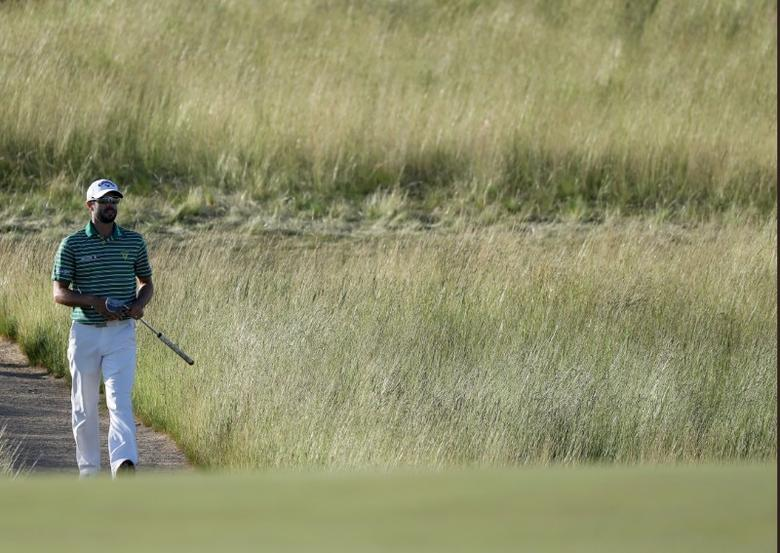 Jun 15, 2017; Erin, WI, USA;  Adam Hadwin walks to the 9th green during the first round of the U.S. Open golf tournament at Erin Hills.  Geoff Burke-USA TODAY Sports