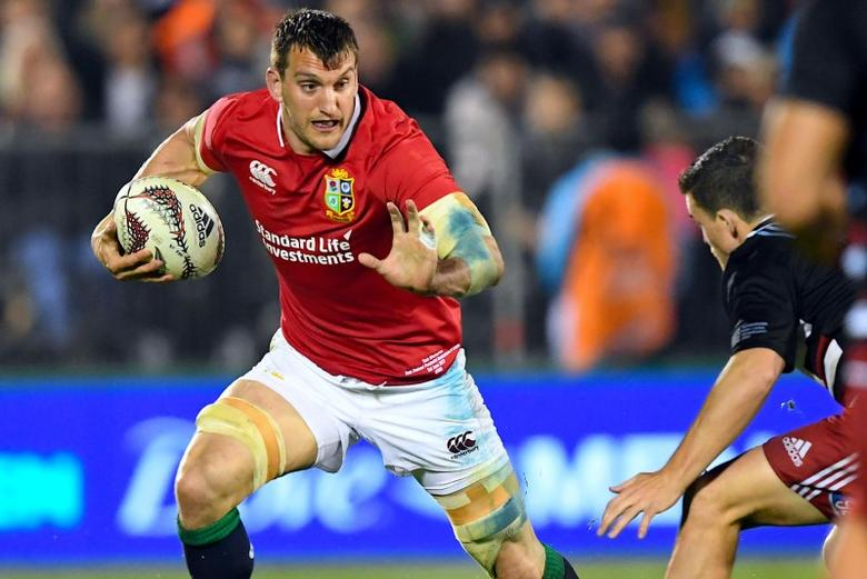 Rugby Union - British and Irish Lions vs New Zealand Barbarians - Whangarei, New Zealand - 3/6/17 - British and Irish Lions' player Sam Warburton runs away from Bryn Gatland of the New Zealand Barbarians. SNPA/Martin England/via REUTERS