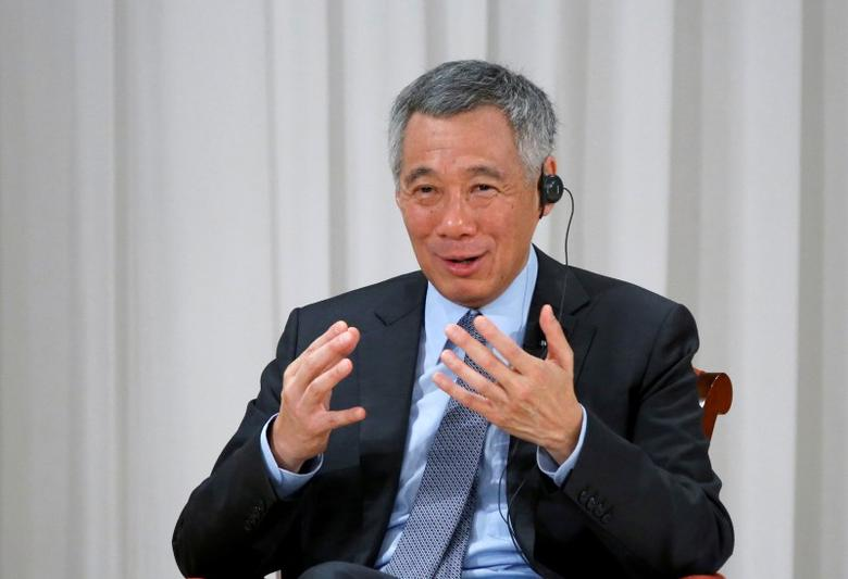 FILE PHOTO: Singapore Prime Minister Lee Hsien Loong speaks at the International Conference on The Future of Asia in Tokyo, Japan, September 29, 2016. REUTERS/Kim Kyung-Hoon/File Photo