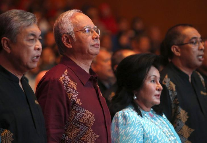 Malaysia's Prime Minister Najib Razak and wife Rosmah Mansor arrives before Najib's National Day speech in the capital city of Kuala Lumpur August 30, 2015. REUTERS/Edgar Su/Files