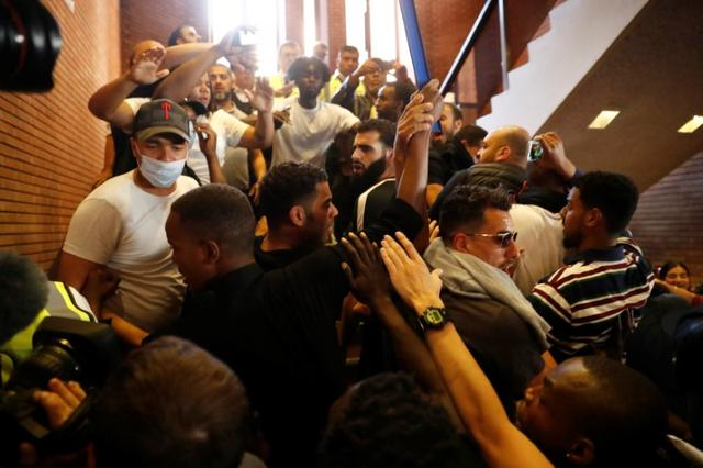 Demonstrators crowd onto a staircase as they enter Kensington Town Hall, during a protest following the fire that destroyed The Grenfell Tower block, in north Kensington, West London, Britain June 16, 2017. REUTERS/Stefan Wermuth