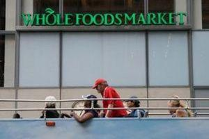 A Whole Foods Market is pictured as a double decker bus goes by in the Manhattan borough of New York City, New York, U.S. June 16, 2017. REUTERS/Carlo Allegri