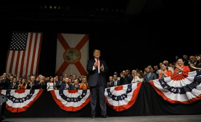 U.S. President Donald Trump applauds as he waits to deliver a speech on US-Cuba relations at the Manuel Artime Theater in Miami, Florida, U.S., June 16, 2017. REUTERS/Carlos Barria