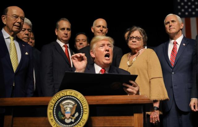 U.S. President Donald Trump speaks as he signs an executive order reversing Obama administration Cuba policies after Trump addressed US-Cuba relations at the Manuel Artime Theater in Miami, Florida, U.S., June 16, 2017. REUTERS/Carlos Barria