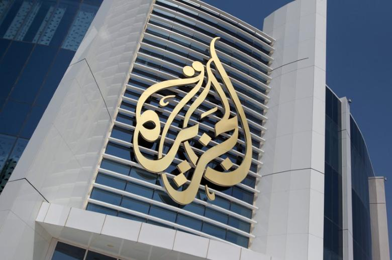 The logo of Al Jazeera Media Network is seen on its headquarters building in Doha, Qatar June 8, 2017. REUTERS/Naseem Zeitoon