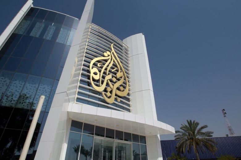 FILE PHOTO: The Al Jazeera Media Network logo is seen on its headquarters building in Doha, Qatar June 8, 2017. REUTERS/Naseem Zeitoon/File Photo