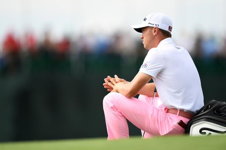 Jun 17, 2017; Erin, WI, USA;  Justin Thomas waits on his bag on the 18th green during the third round of the U.S. Open golf tournament at Erin Hills. Mandatory Credit: Michael Madrid-USA TODAY Sports