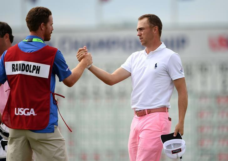 Jun 17, 2017; Erin, WI, USA;  Justin Thomas greets playing partner Jonathan Randolph's caddie David Dubord on the 18th green following their third round of the U.S. Open golf tournament at Erin Hills. Mandatory Credit: Michael Madrid-USA TODAY Sports