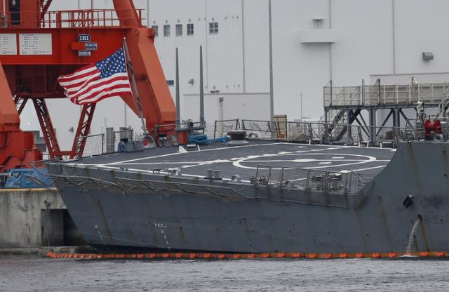 The U.S. national flag is seen on the Arleigh Burke-class guided-missile destroyer USS Fitzgerald, which has been damaged from colliding with a Philippine-flagged merchant vessel, at the U.S. naval base in Yokosuka the U.S. naval base in Yokosuka, Japan June 18, 2017. REUTERS/Toru Hanai
