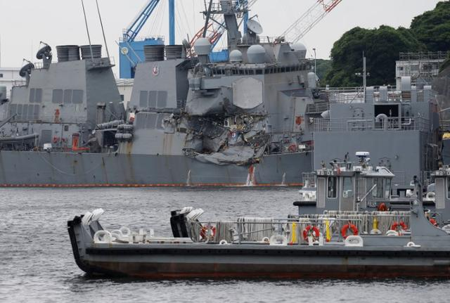 The Arleigh Burke-class guided-missile destroyer USS Fitzgerald, damaged by colliding with a Philippine-flagged merchant vessel, is seen at the U.S. naval base in Yokosuka, Japan June 18, 2017. REUTERS/Toru Hanai