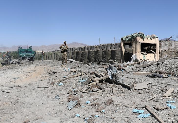 Afghan security forces inspect the aftermath of a suicide bomb blast in Paktia Province, Afghanistan June 18, 2017. REUTERS/Samiullah Peiwand