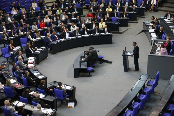 Cem Oezdemir of the environmental Greens party (Die Gruenen) addresses a session of the Bundestag, lower house of parliament, being held to debate approval of a symbolic resolution that declares the 1915 massacre of Armenians by Ottoman forces a ''genocide'', in Berlin, Germany, June 2, 2016.   REUTERS/Hannibal Hanschke