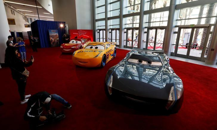 A Lightning McQueen, a Cruz Ramirez and a Jackson Storm vehicles are pictured at the premiere of ''Cars 3'' at the convention center in Anaheim, California U.S., June 10, 2017.   REUTERS/Mario Anzuoni/Files