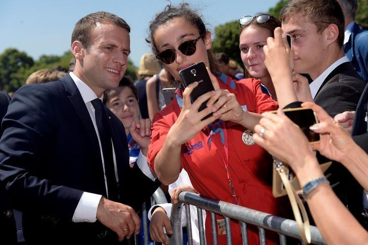 French President Emmanuel Macron (L) attends a ceremony marking the 77th anniversary of late French General Charles de Gaulle's resistance call of June 18, 1940, at the Mont Valerien memorial in Suresnes, near Paris, France, June 18, 2017.  REUTERS/Bertrand Guay/Pool