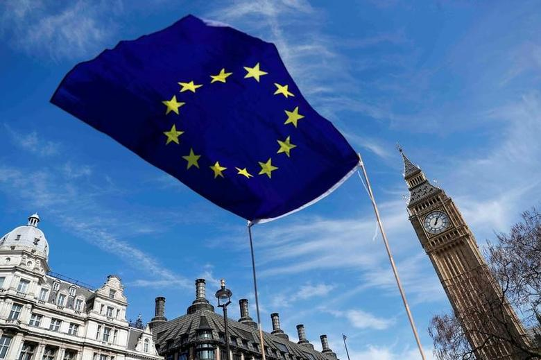 FILE PHOTO: An EU flag flies above Parliament Square during a Unite for Europe march, in London, Britain March 25, 2017.    REUTERS/Peter Nicholls/File Photo - RTX38QBA
