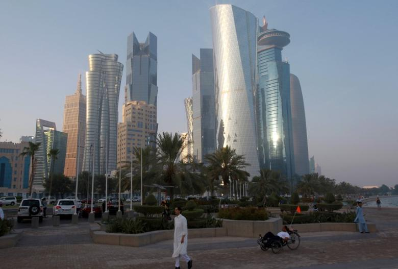A man walks on the corniche in Doha, Qatar, June 15, 2017. REUTERS/Naseem Zeitoon