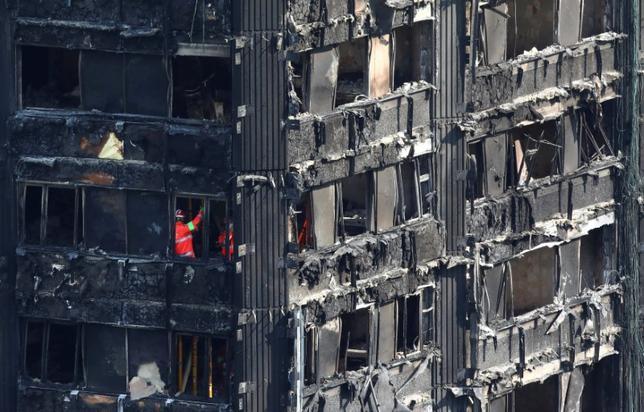 6月18日、ロンドン警察のカンディ署長は、24階建て高層公営住宅「グレンフェル・タワー」で起きた火災について、死亡者および死亡の可能性が高い行方不明者が79人になったと明らかにした。(2017年 ロイター/Neil Hall)