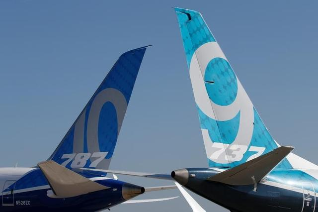 FILE PHOTO: Empennage of a Boeing 737 MAX and a 787 are seen on the static display, before the opening of the 52nd Paris Air Show at Le Bourget Airport near Paris, France June 17, 2017. REUTERS/Pascal Rossignol