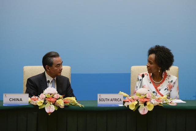 South Africa's Foreign Minister Maite Nkoana-Mashabane (R) looks at China's Foreign Minister Wang Yi (L) as she speaks at a news conference during the BRICS Foreign Ministers meeting in Beijing, China June 19, 2017.  REUTERS/Wang Zhao/Pool
