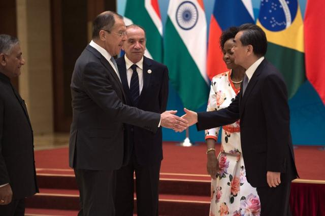 Brazil's Foreign Minister Aloysio Nunes (C), Russia's Foreign Minister Sergey Lavrov (2nd L), South Africa's Foreign Minister Maite Nkoana-Mashabane (2nd R) and Indian Minister of External Affairs Vijay Kumar Singh (L) meet with China's Foreign Minister Wang Yi (R) before the opening of the BRICS Foreign Ministers meeting in Beijing on June 19, 2017. REUTERS/Nicolas Asfouri/Pool