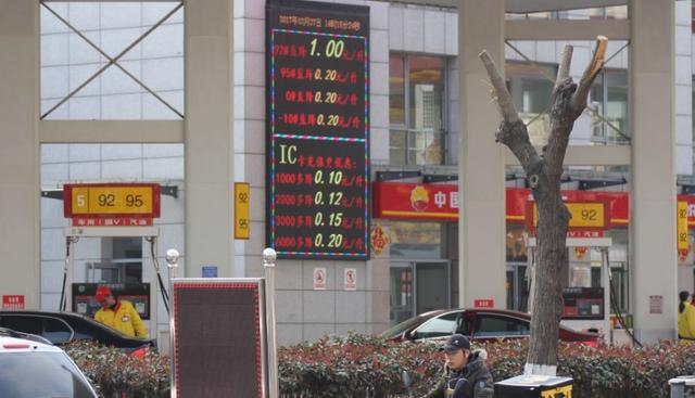 FILE PHOTO: Discounts of gasoline prices are displayed at a CNPC gas station in Qingdao, Shandong province, China March 27, 2017. REUTERS/Stringer