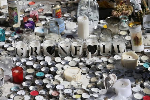 A tribute to the victims of the Grenfell Tower fire is seen in North Kensington, London, Britain, June 19, 2017. REUTERS/Marko Djurica