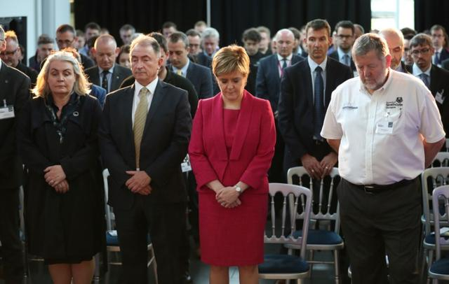 Scotland's First Minister Nicola Sturgeon observes a minute's silence in memory of those who died in the Grenfell Tower fire during a visit to the Advanced Forming Research Centre in Renfrew, Glasgow,  June 19, 2017. REUTERS/Jane Barlow/Pool