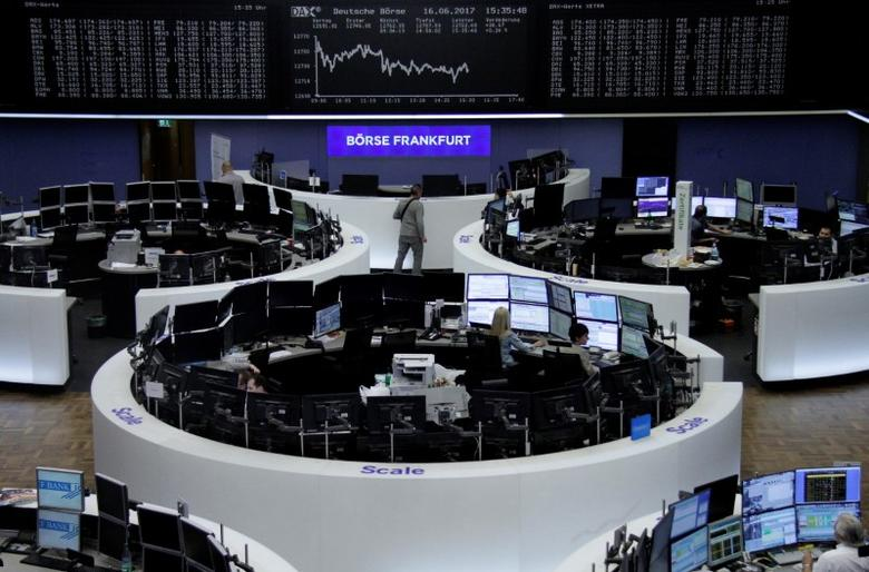 Traders work in front of the German share price index, DAX board, at the stock exchange in Frankfurt, Germany, June 16, 2017. REUTERS/Staff/Remote
