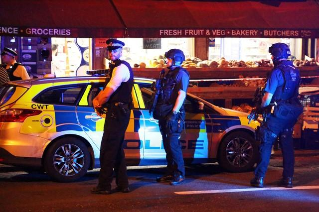 Police officers attend to the scene after a vehicle collided with pedestrians in the Finsbury Park neighbourhood of North London. REUTERS/James Cropper