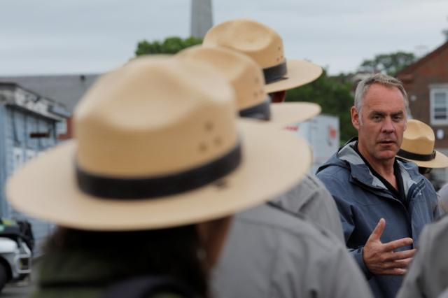 U.S. Interior Secretary Ryan Zinke (C) talks to National Park Service Rangers, while traveling for his National Monuments Review process, in Boston, Massachusetts, U.S., June 16, 2017.    REUTERS/Brian Snyder
