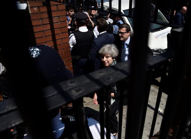 Britain's Prime Minister Theresa May arrives at the Finsbury Park Mosque after a van was driven at Muslims outside the mosque in North London, Britain, June 19, 2017. REUTERS/Hannah McKay