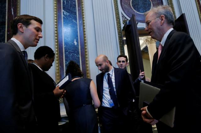 Alphabet Executive Chairman Eric Schmidt (R) speaks with White House senior adviser Jared Kushner (L) as tech company leaders gather at a summit of the American Technology Council at the Eisenhower Executive Office Building in Washington, U.S. June 19, 2017.  REUTERS/Jonathan Ernst