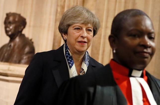 6月21日、英国のメイ首相(写真)は22日に行われるEU首脳会議の場で在英EU市民の権利保障について「基本方針」を説明する見通し。ロンドンで代表撮影(2017年 ロイター)