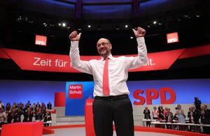 German Chancellor candidate Schulz of the SPD reacts after delivering his...