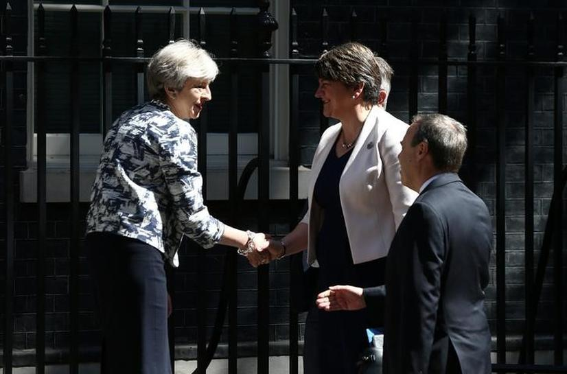 UK PM May strikes 1 billion pound deal to get Northern Irish DUP support for her government