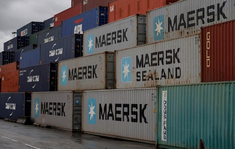 Empty Maersk shipping containers are seen stacked at Peel Ports container terminal in Liverpool northern England, December 9, 2016. REUTERS/Phil Noble/File Photo