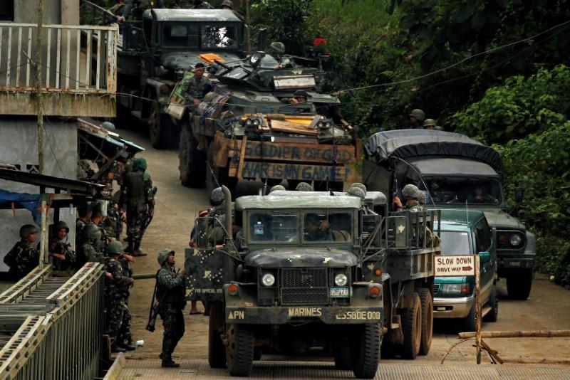 Philippines says beheaded civilians found in rebel-held town - Reuters