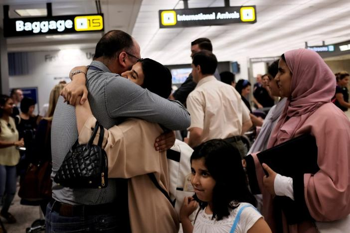 A family embraces each other as members arrive at Washington Dulles International Airport after the U.S. Supreme Court granted parts of the Trump administration's emergency request to put its travel ban into effect later in the week pending further judicial review, in Dulles, Virginia, U.S., June 26, 2017. James Lawler Duggan