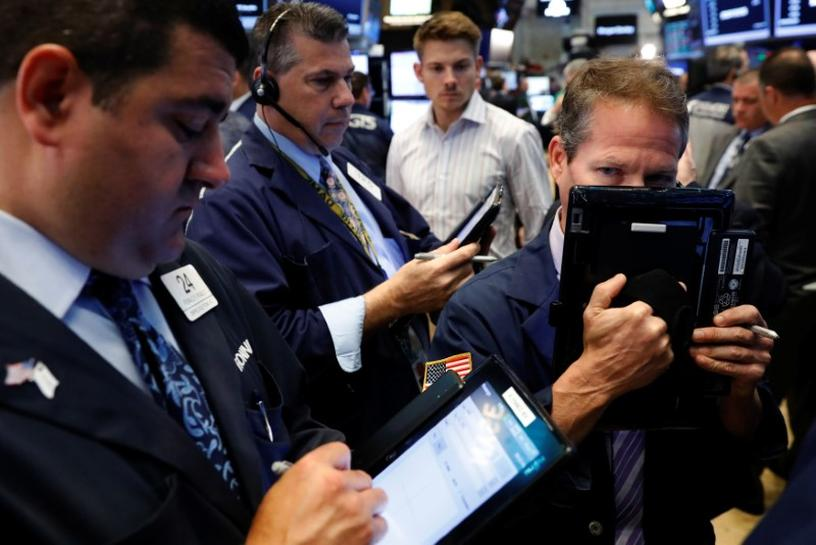 Wall Street ends bumpy week, strong first half with modest gain