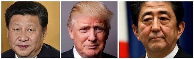 7月1日、トランプ米大統領は、2日に中国の習近平国家主席、安倍首相とそれぞれ電話で会談する(2017年 ロイター/Kevin Lamarque/Toru Hanai/Lucas Jackson)