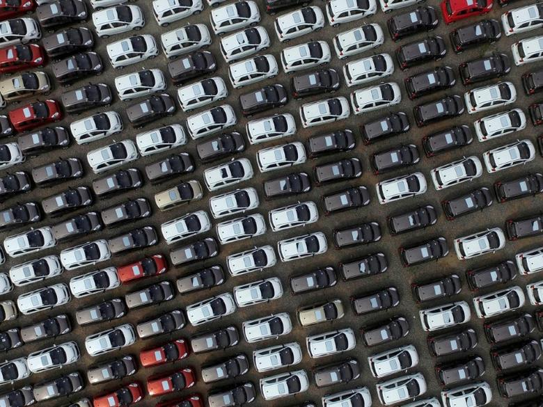 Electric cars are seen at a parking lot of an automobile factory in Xingtai, Hebei province, China April 26, 2016. Stringer