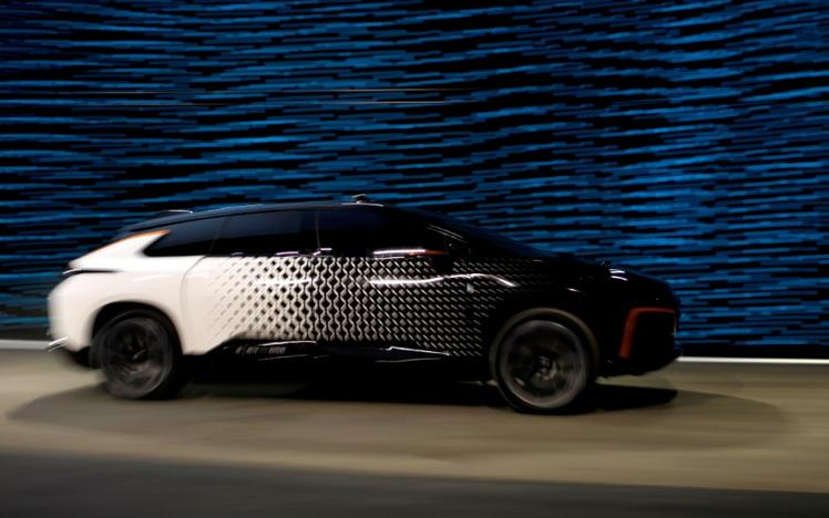A Faraday Future FF 91 electric car takes off across the stage in an exhibition of speed during an unveiling event at CES in Las Vegas, Nevada January 3, 2017. Steve Marcus