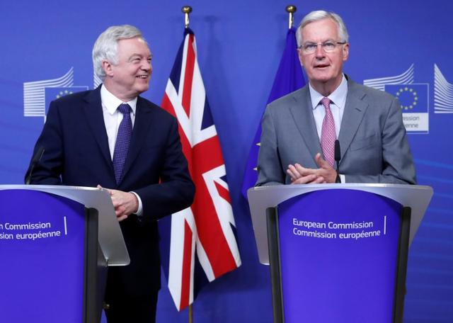 UK Secretary of State for Exiting the European Union David Davis (L) and the European Commission's Chief Brexit Negotiator Michel Barnier talk to reporters at the start of a first full round of talks on Britain's divorce terms from the European Union, in Brussels, Belgium July 17, 2017. REUTERS/Yves Herman
