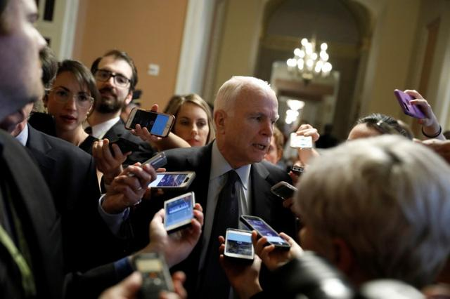 Sen. John McCain (R-AZ) speaks with reporters about the Senate health care bill on Capitol Hill in Washington, U.S., July 13, 2017. REUTERS/Aaron P. Bernstein