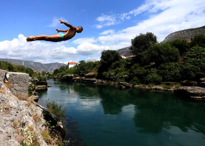 Lorens Listo trains before the 451st traditional diving competition in Mostar, Bosnia and Herzegovina, July 25, 2017. REUTERS/Dado Ruvic